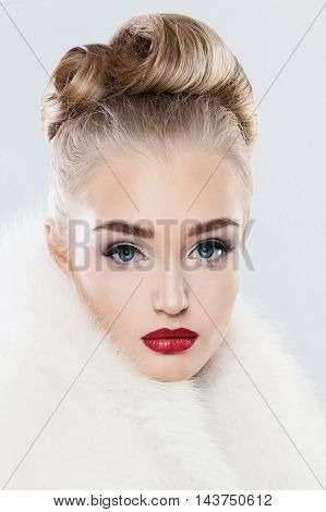 Cute Face. Woman with Makeup Fashionable Hairstyle and White Fur