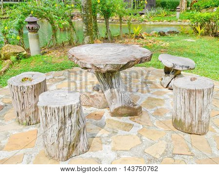 wooden table and log stool in the garden