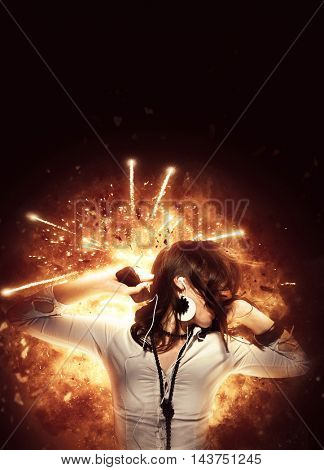 girl with headphones explosion background