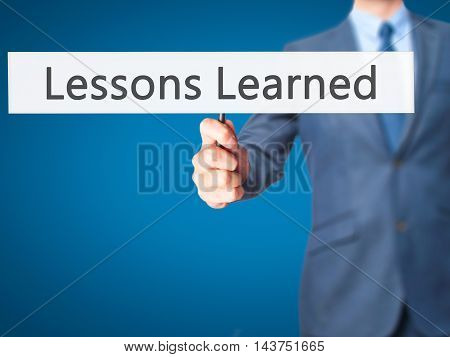 Lessons Learned - Business Man Showing Sign