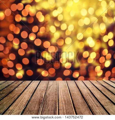 Abstract Christmas table background - Beautiful wood board table in front of Christmas glitter lights with festive bokeh