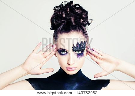 Cute Fashion Girl with Creative Hairstyle and Makeup