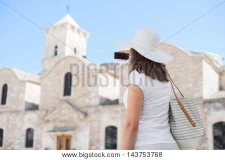 Teenage girl taking selfie. Young and beautiful woman have a weekend in Larnaca. Vacation, holidays and traveling concept.