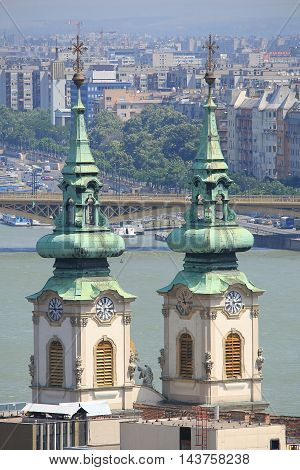 Traditional church towers and tourist Danube river Budapest Hungary