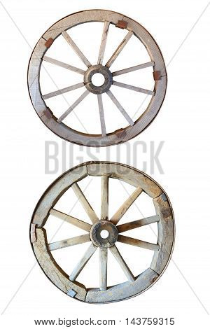 two old wooden grunge wagon wheel isolated on white background