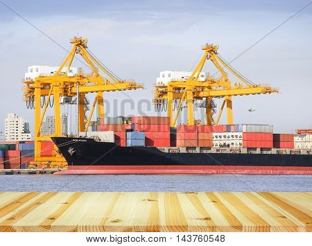 Cargo freight ship and cargo container working with crane at port for logistics and transportation background.