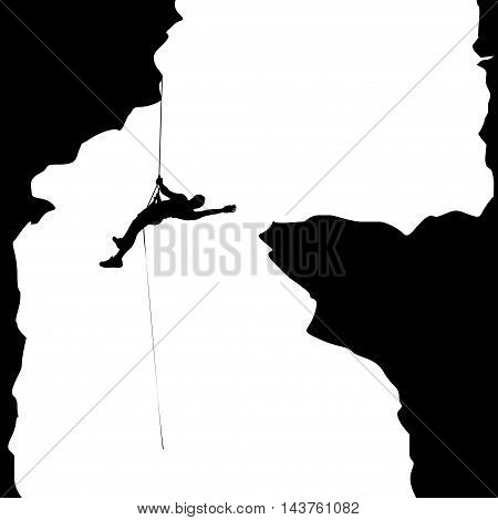 illustration of black color male rock climber silhouette hanging in big cave