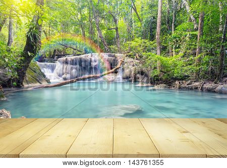 Scenery of Erawan waterfall montage with wood floors.