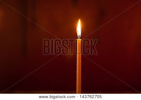 light candle in οrthodox church in Greece