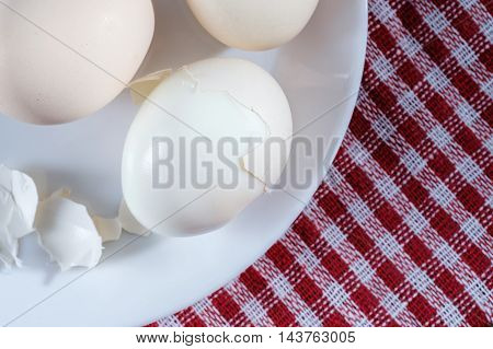 Boiled Eggs With Shell On The White Plate