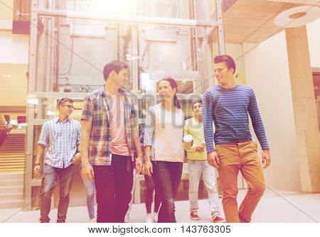 education, high school, friendship, drinks and people concept - group of smiling students with paper coffee cups