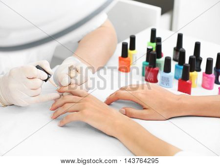 Woman getting a manicure in a beauty salon, close up