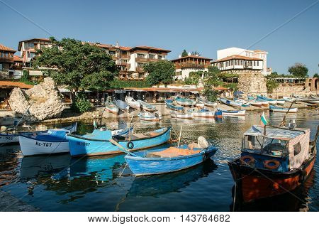 NESSEBAR BULGARIA AUGUST 31 2015: Old wooden fishing boat in port of ancient town on the Black Sea coast of Bulgaria