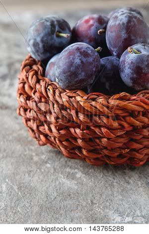 Ripe Plums Scattered On A Gray Wooden Background. Bio Healthy Fr
