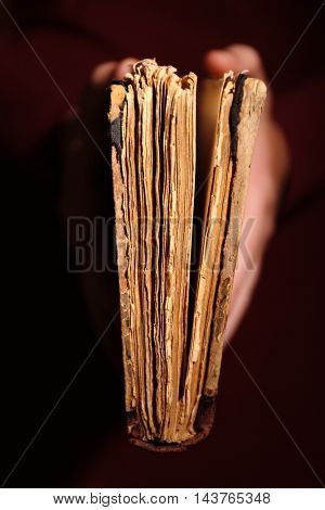 Woman hands holding old book
