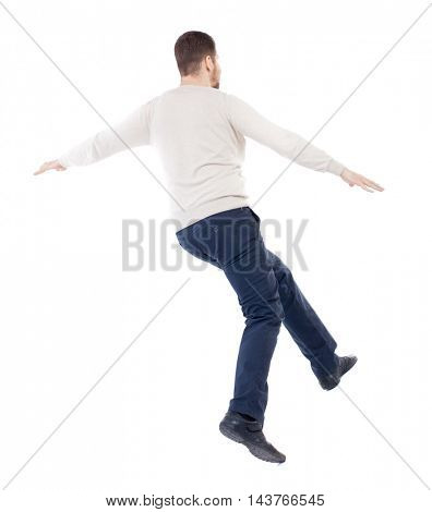 Balancing young man.  or dodge the falling man. Rear view people collection.  backside view of person.  Isolated over white background. The bearded man in a white warm sweater covers her eyes....