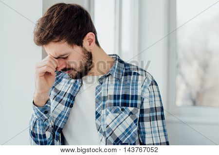 Young man having a problem and being sad. Tiredness concept