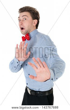 The guy in a shirt and bow tie locked arms experiencing negative emotions. disgust, does not agree, disagree, fear. Isolated over white. Businessman in a shirt and a bow tie is protected by hands in