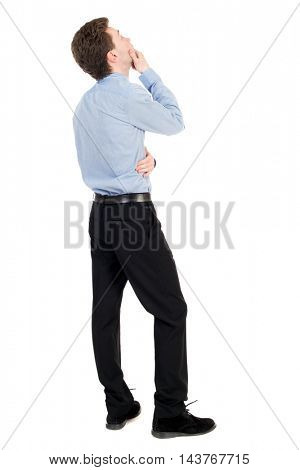 back view of standing business man. Young businessman scratches his head in amazement. Rear view people collection.  backside view of person.  Isolated over white background. The curly-haired