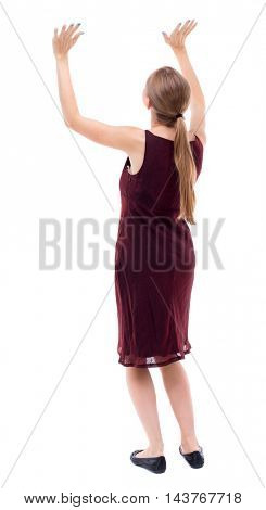back view of woman  protects hands from what is falling from above. woMan holding a heavy load Rear view people collection.  backside view of person.  Isolated over white background. A girl in a