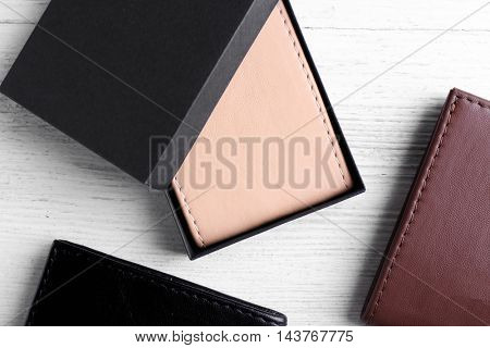 Leather wallets on wooden background