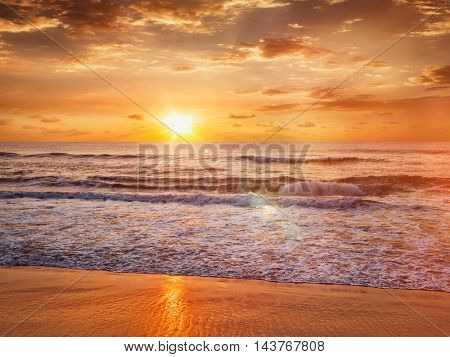 Beach holidays vacation background - peaceful serene morning sunrise on beach