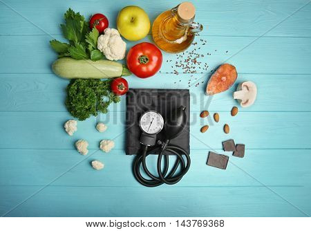 Healthy food with tonometer on table. Heart health concept