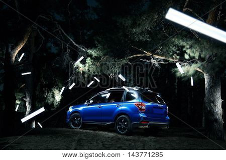 Saratov, Russia - September 28, 2015: Car Subaru Forester stand in forest concept lights at night
