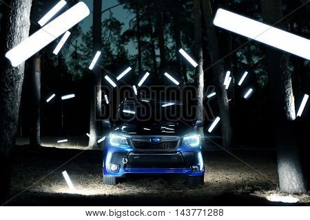 Saratov, Russia - September 28, 2015: Car Subaru Forester Stand In Forest, Concept Lights At Night