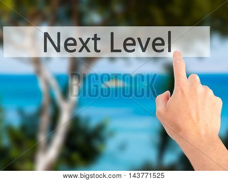 Next Level - Hand Pressing A Button On Blurred Background Concept On Visual Screen.