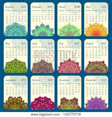 2017 Calendar decorated with circular flower mandala. Vector illustration