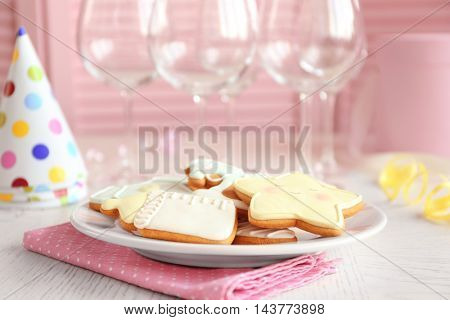 Baby glazed cookies on decorated table