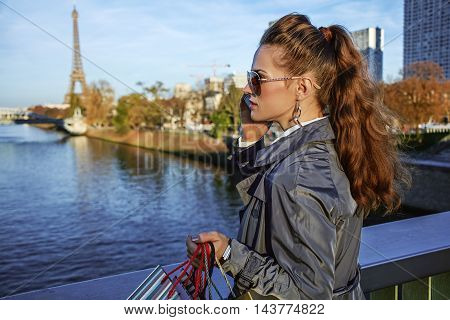 Young Trendy Woman Speaking On Cell Phone Near Eiffel Tower