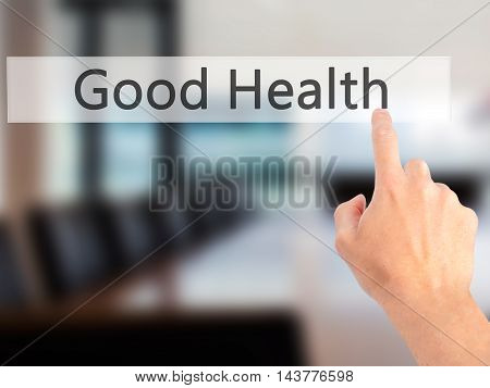 Good Health - Hand Pressing A Button On Blurred Background Concept On Visual Screen.