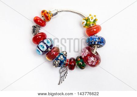 Bijouterie with red and blue beads on white background