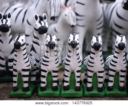 small zebra statues background in garden - black and white animal statues