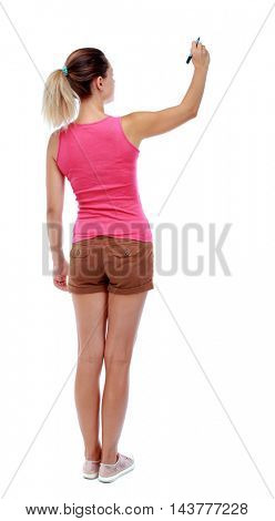 back view of writing beautiful woman. Rear view people collection.  backside view of person. Isolated over white background. Sport blond in brown shorts writes over your head.