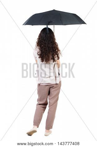 young woman in  dress under an umbrella. Rear view people collection.  backside view of person.  Isolated over white background. Long-haired curly girl hiding under an umbrella.