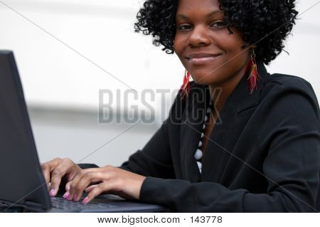 Lady On Computer Smiles