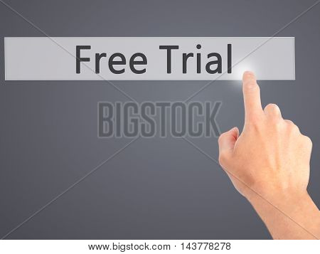 Free Trial - Hand Pressing A Button On Blurred Background Concept On Visual Screen.