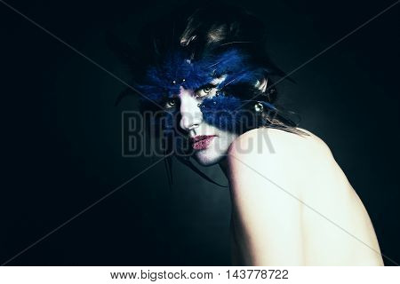 Fantasy concept. Woman with Art Makeup. Fantasy Blue Bird. Stage Makeup