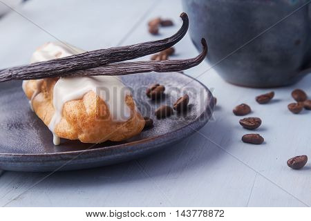 Traditional French Cuisine. Eclair Drizzled With White Icing On