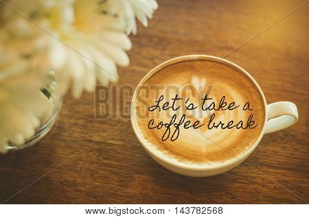 Let's take a coffee break : Quote with coffee cup on wood background