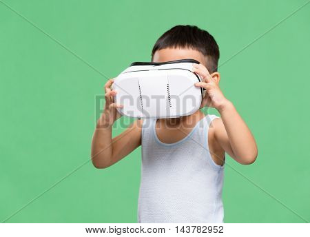 Little boy watching though VR