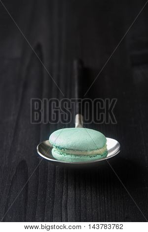 Traditional French Sweets. Green Mint Macaroon. Black Stone Back