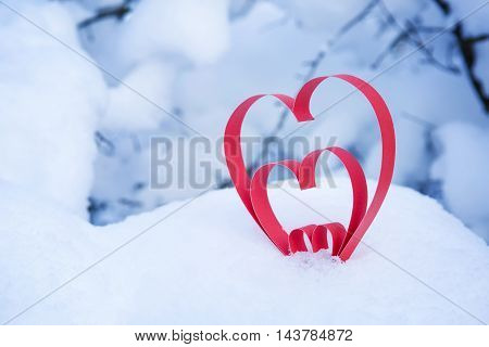 Heart in a snow-covered snowdrift. Concept of Christmas and Valentine's Day