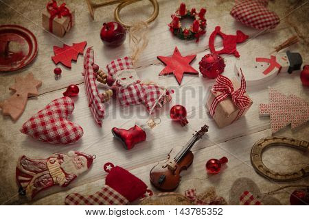 Collection of different small pieces of christmas decoration in red and white checkered.