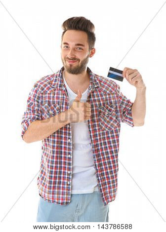 Young man holding credit card on white background