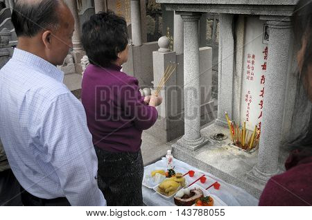 HONG KONG, CHINA - 19 Jan 2008: A traditional Chinese memorial ceremony taking place at a cemetary in central Hong Kong.