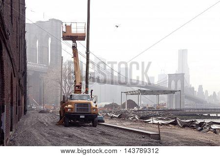 Construction site beneath Brooklyn Bridge in New York.
